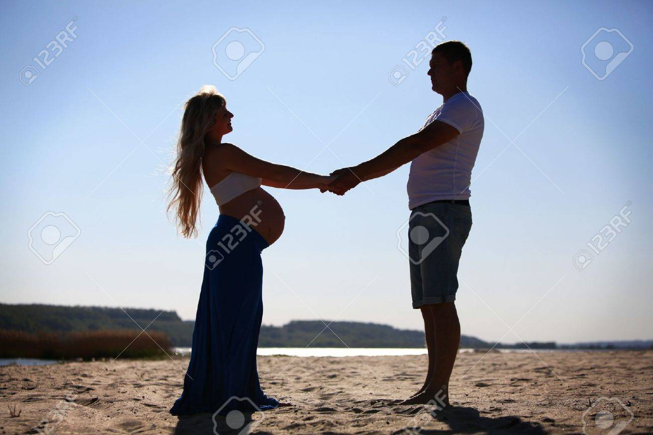 Silhouette of pregnant woman and man Stock Photo - 14614710