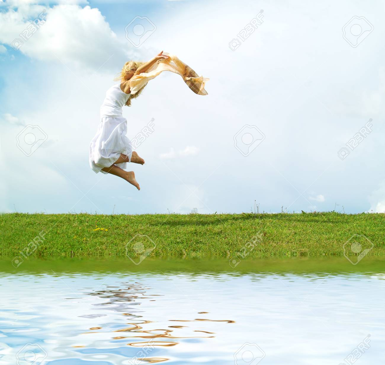 A young lady jumping on the background of the sky Stock Photo - 3319704