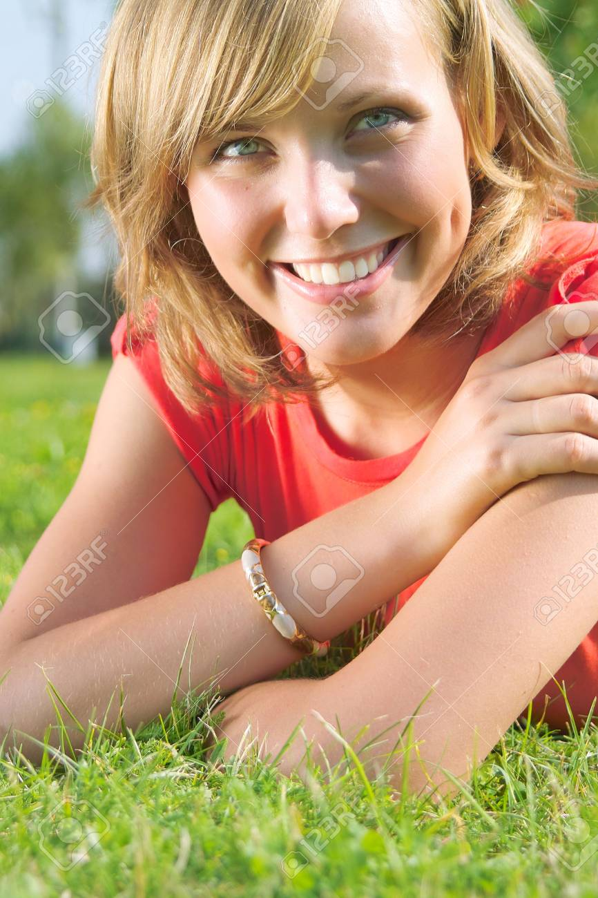Beautiful lady in red shirt relaxing in the park Stock Photo - 3468030