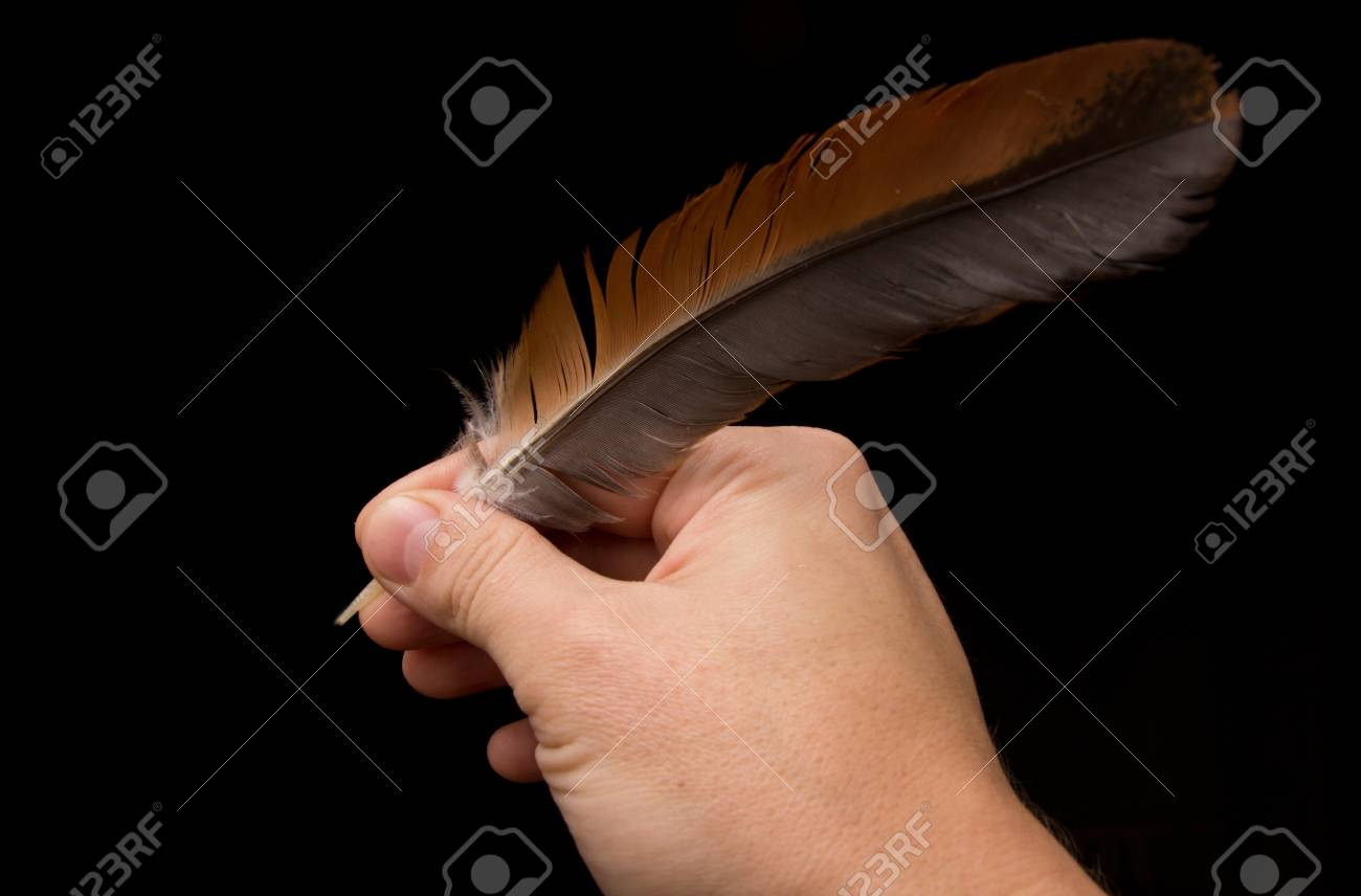 Hand writting with feather isolated on black background Stock Photo - 13204714