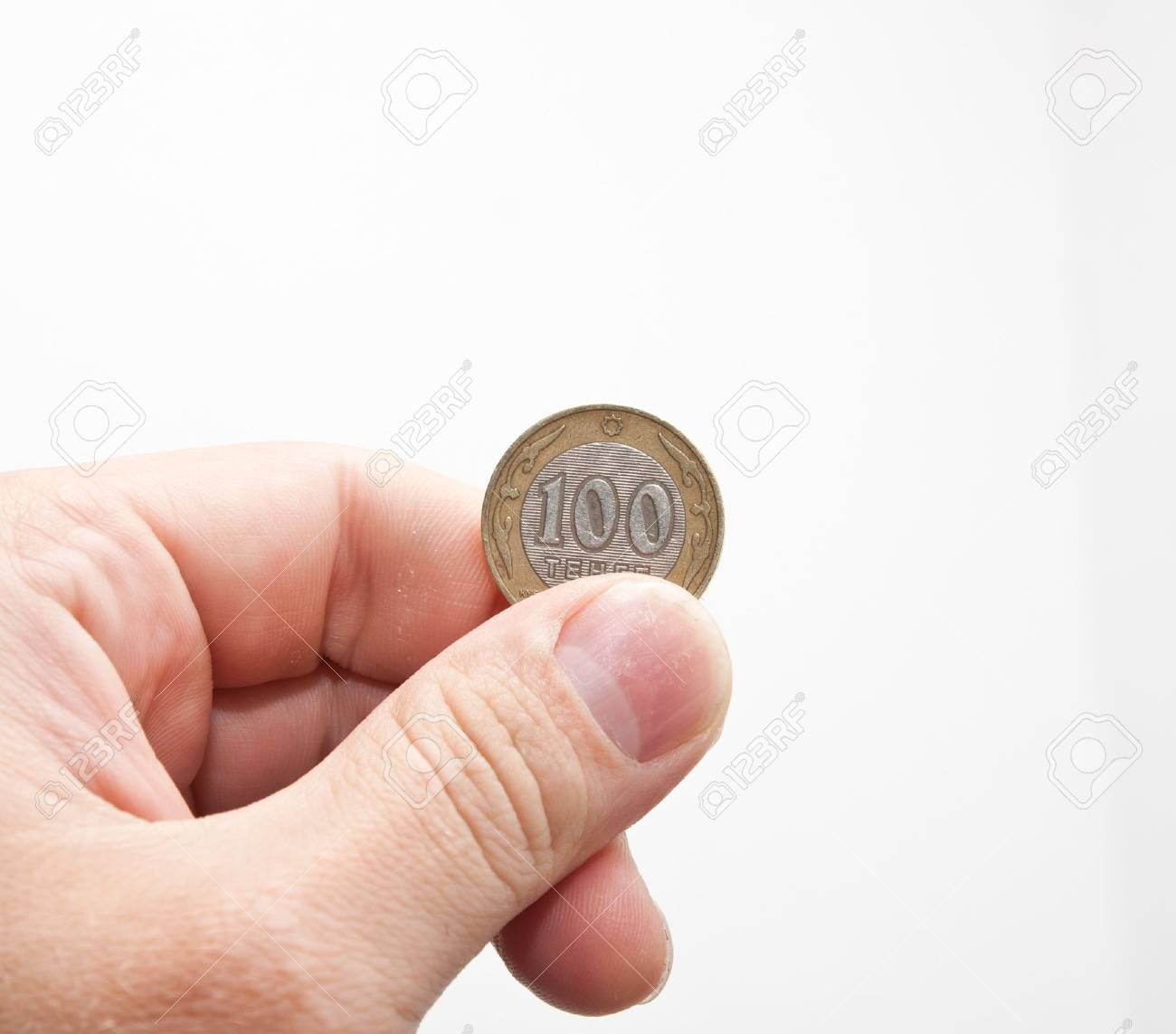 tenge in hand on white background Stock Photo - 14425227