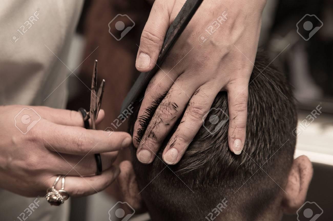Men's haircut at the barber scissors Stock Photo - 24048617