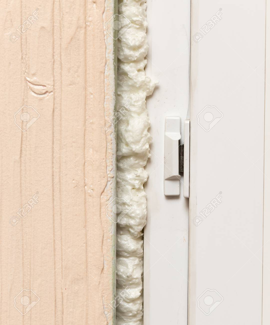 Fixing the gap in the door with construction foam . Stock Photo - 92297763 & Fixing The Gap In The Door With Construction Foam . Stock Photo ...