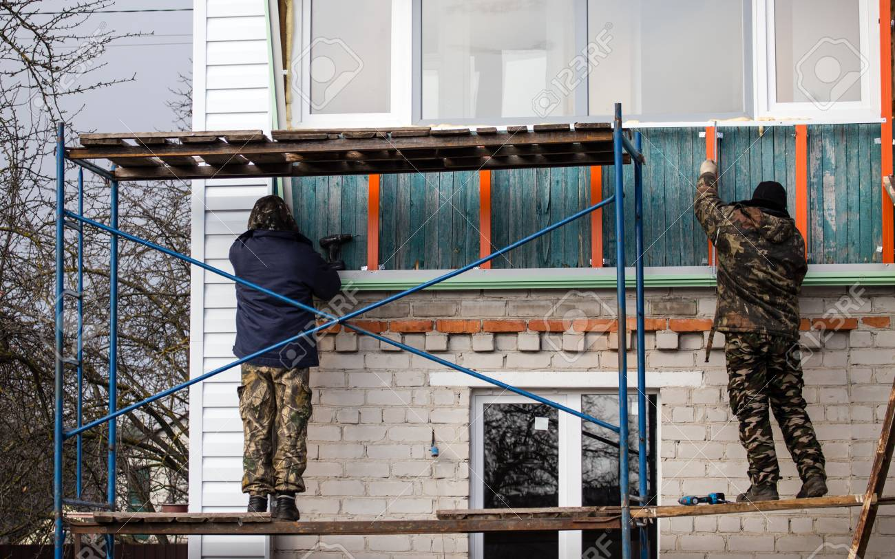 workers walling the house with wall siding stock photo picture rh 123rf com house with wallpaper design house with one wall