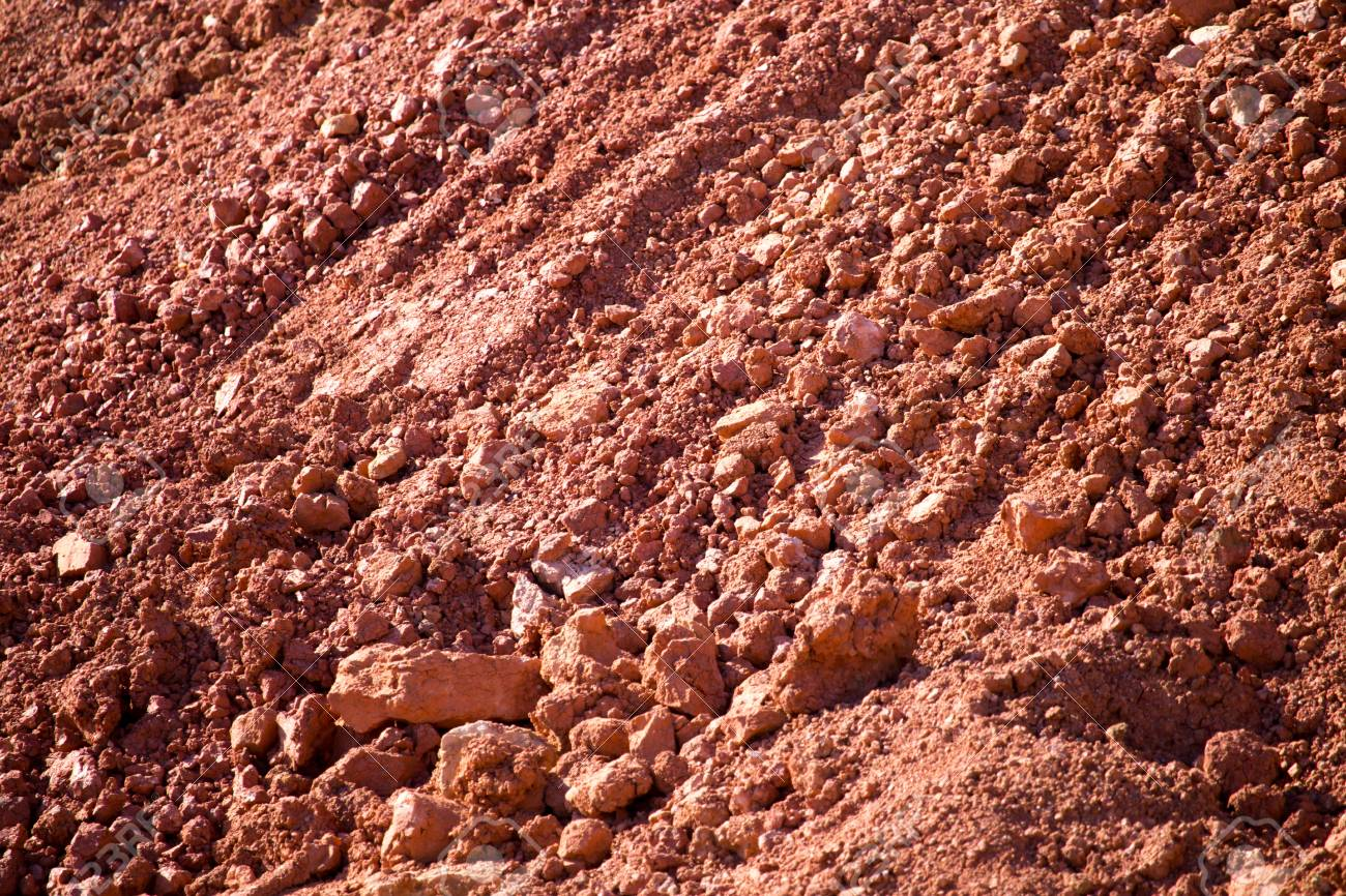 Red clay soil on nature as a background . - 92980942