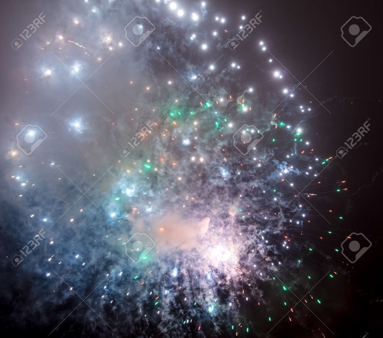 Beautiful sparks from fireworks in the sky at night. - 121326145