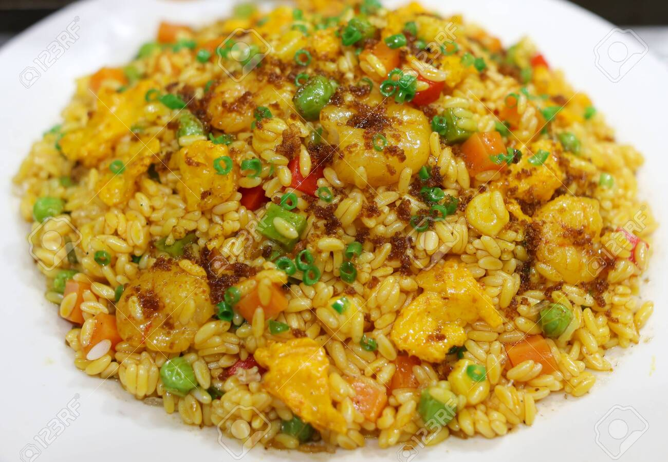 Rice cooked according to a special recipe. A dish of Chinese cuisine. - 142549928