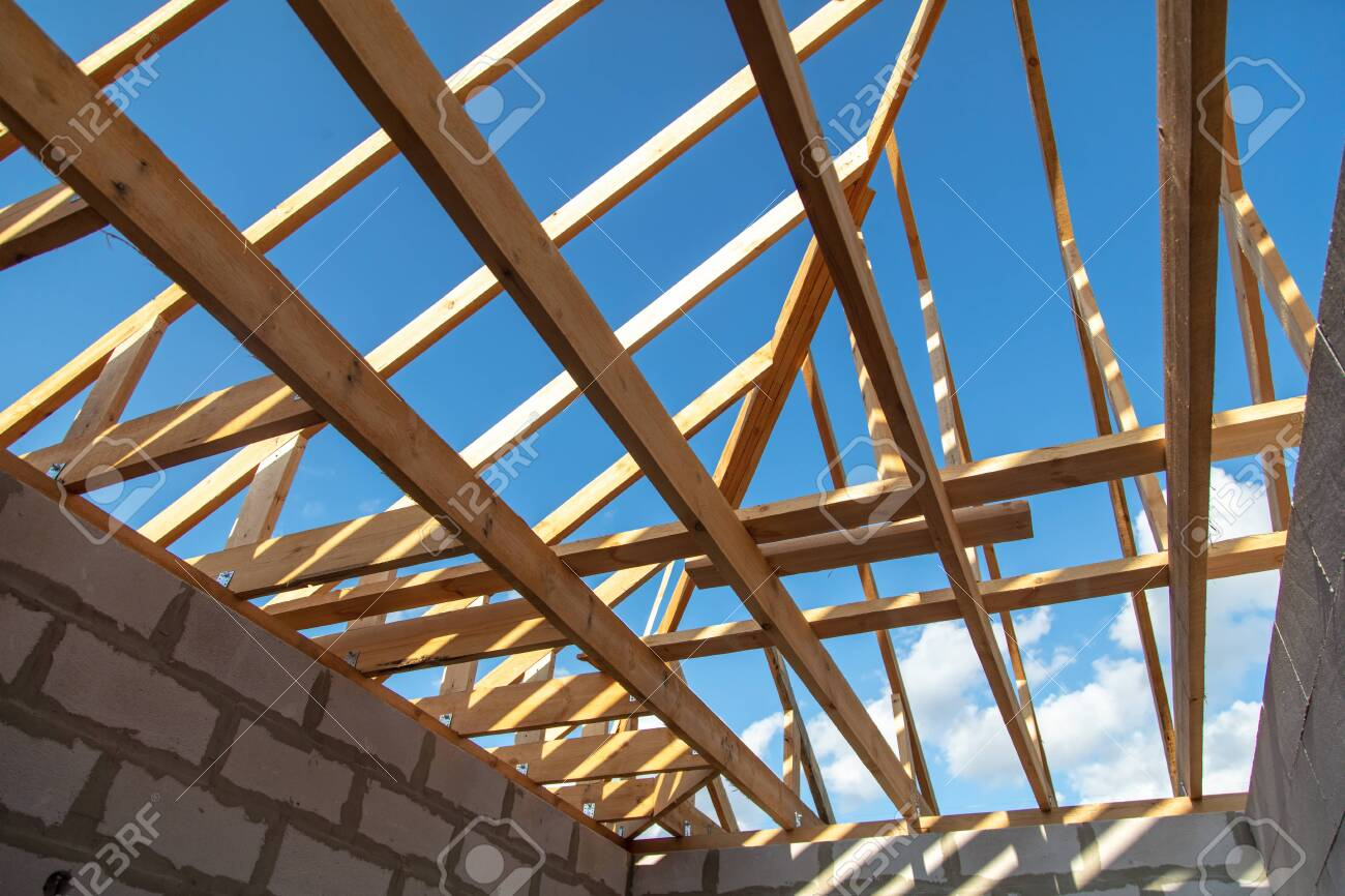 Wooden boards on the roof of the house against the sky. Home construction - 148254054