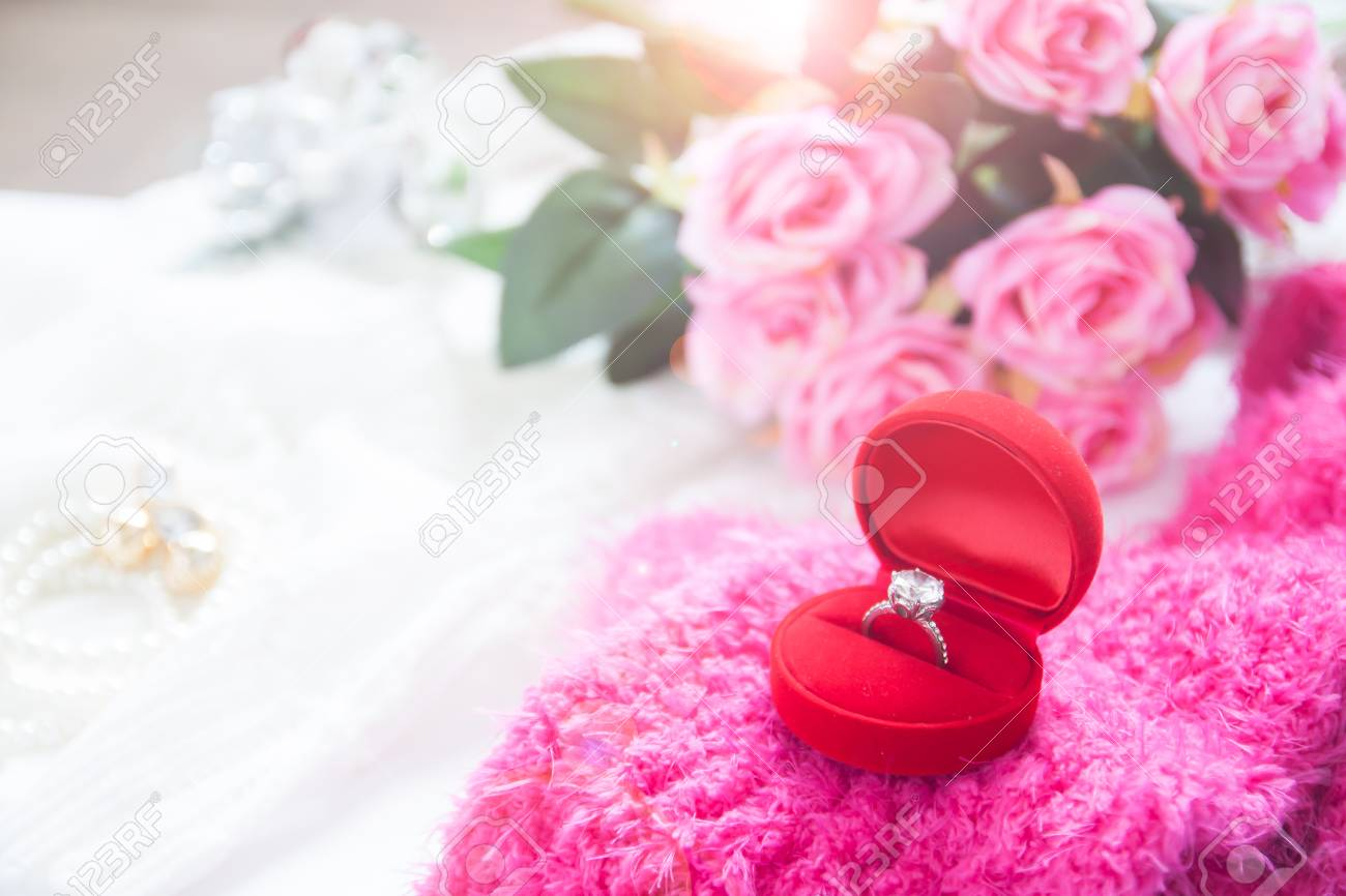 Wedding Ring, Diamond Ring In Red Box With Pink Roses And Bride ...