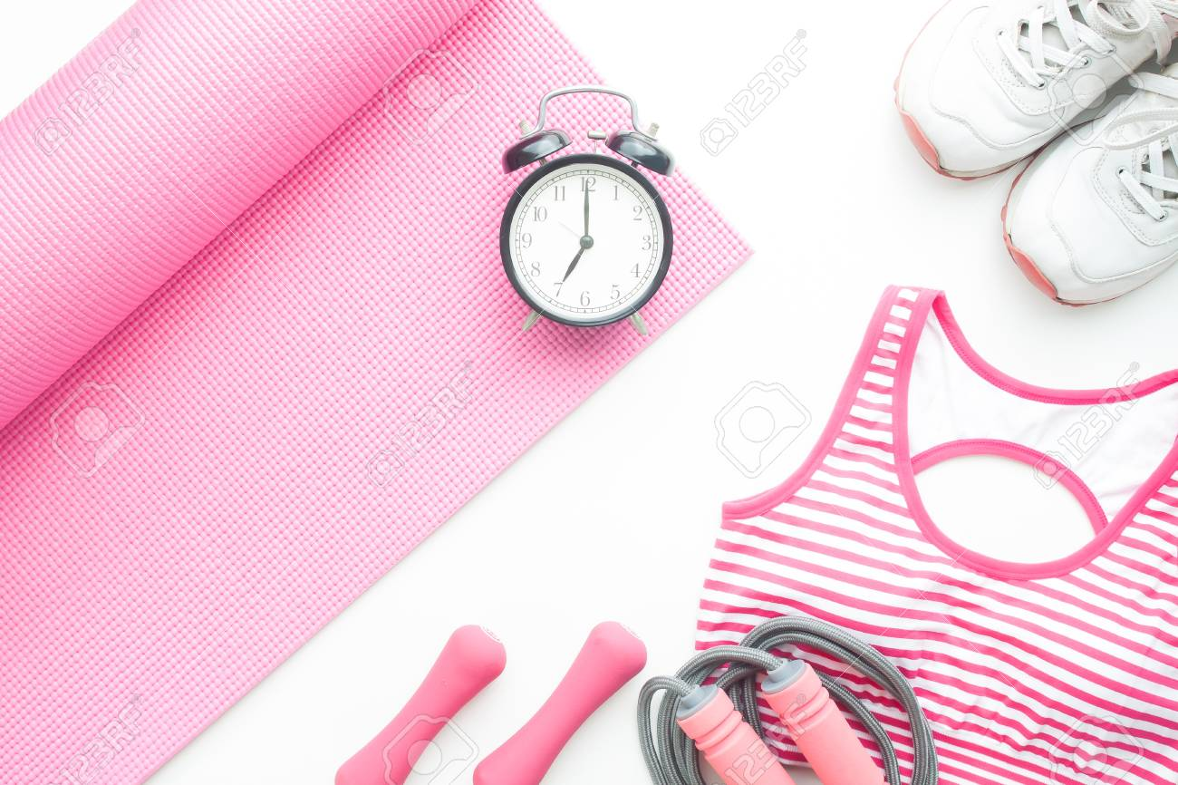 Top View Of Yoga Fitness Items And Alarm Clock On White Background Stock Photo Picture And Royalty Free Image Image 95081507