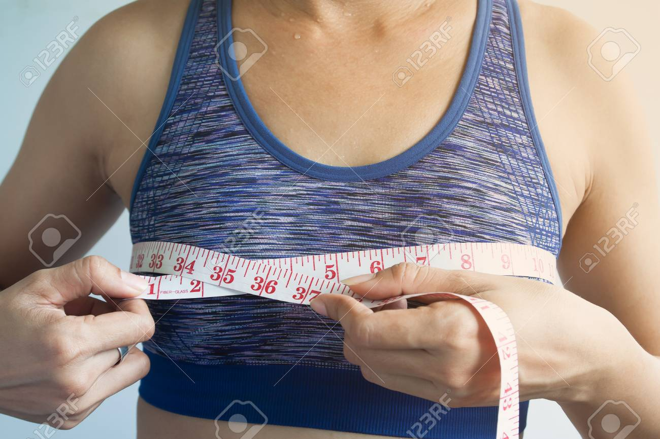 Asian woman measuring breasts, Cancer or surgery concept - 110674497