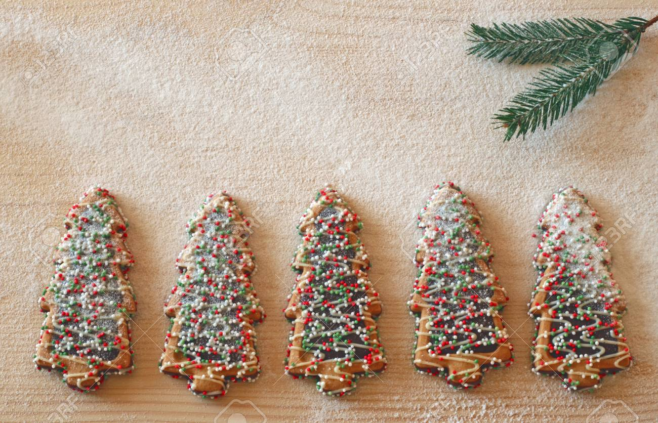Row Of Colorful Decorated Christmas Tree Cookies Covered With