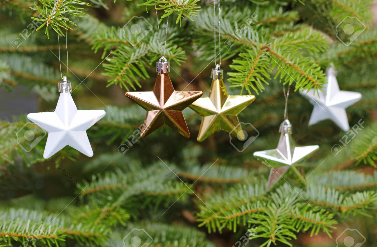 Different Colored Stars Hanging On A Christmas Tree, Close-up Stock ...