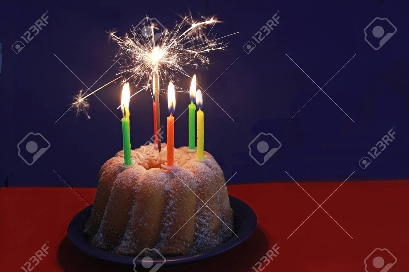 Pleasing Birthday Cake For A Child With Burning Candles And A Sparkler Funny Birthday Cards Online Alyptdamsfinfo
