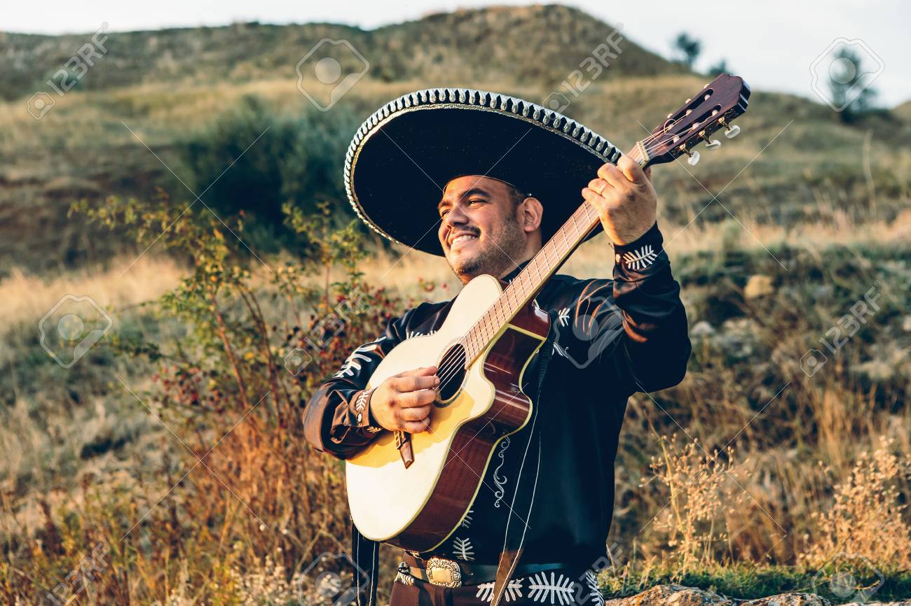 Musician mariachi with guitar on the coast. - 89596309