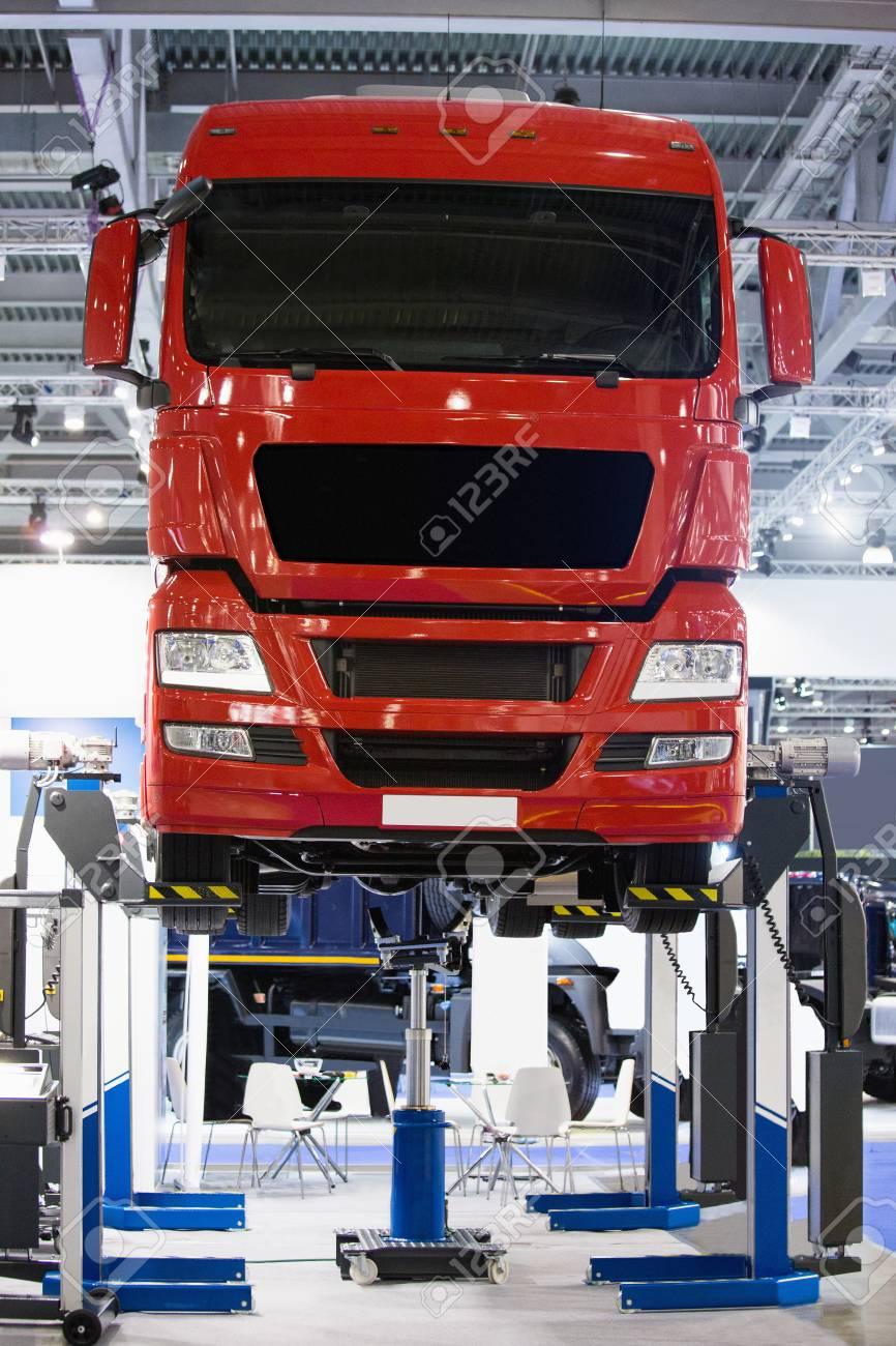 Truck on a column lift in a car service - 90395687