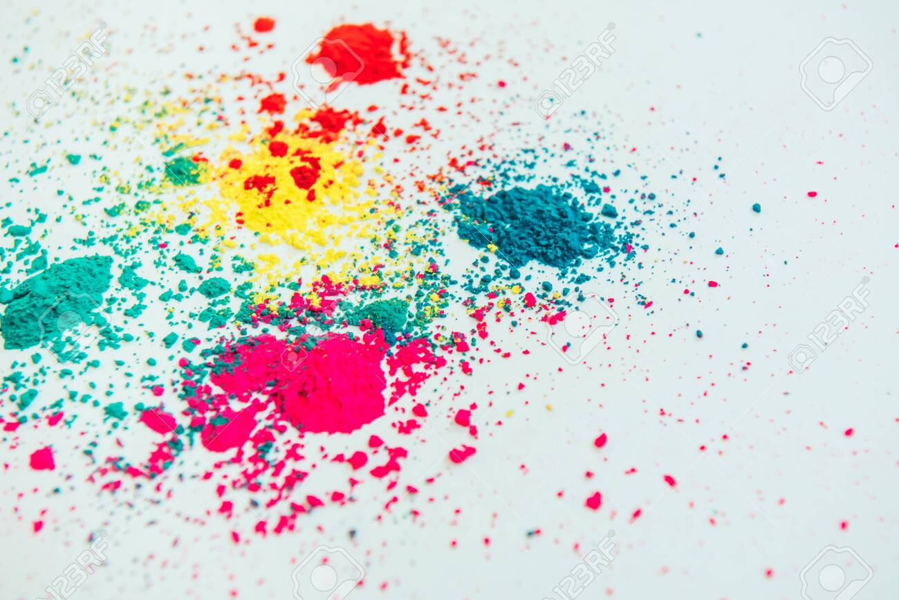 Abstract multicolor powder mixed on white background. Freeze motion of color powder. Concept Indian festival Holi. - 146500964