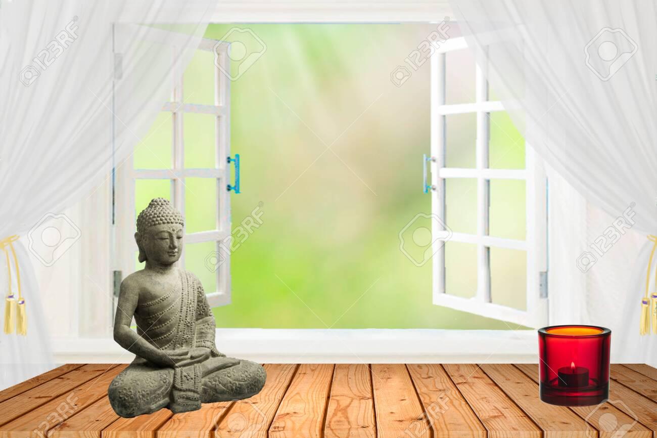 Living room interior decor: buddha statue on the table near the..