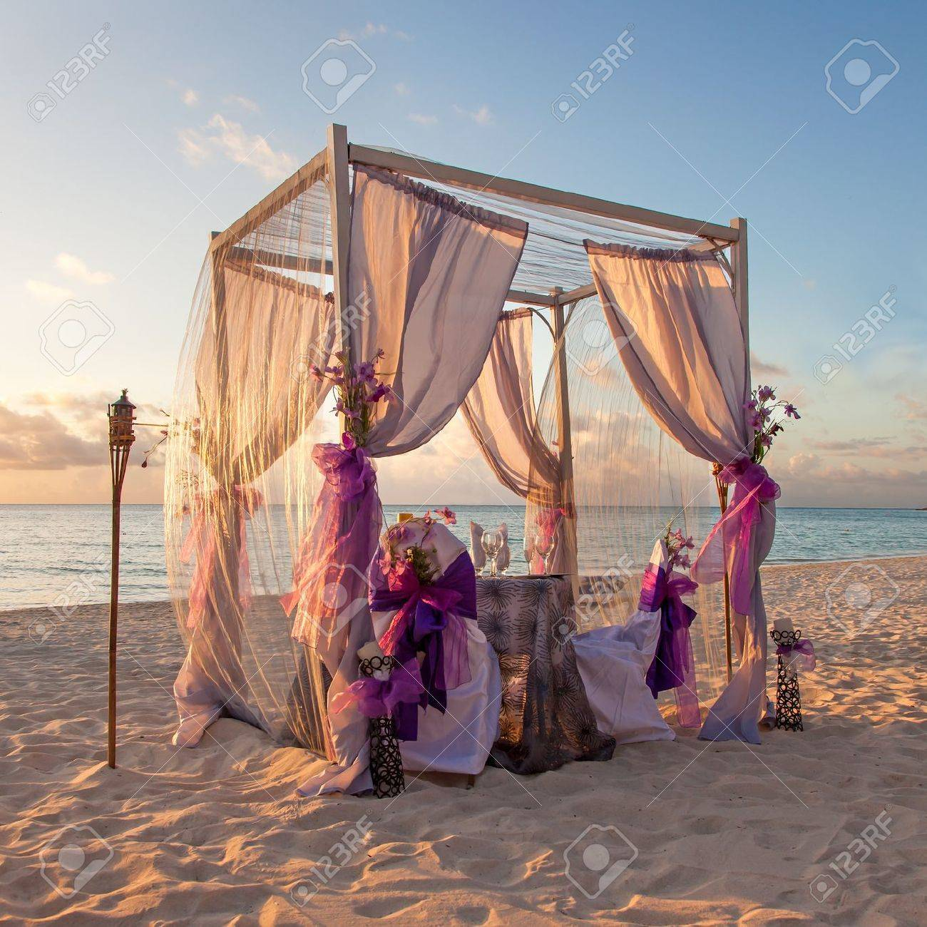 Beautiful Decorated Romantic Wedding Table on Sandy Tropical Caribbean Beach at Sunset Stock Photo - 14641511