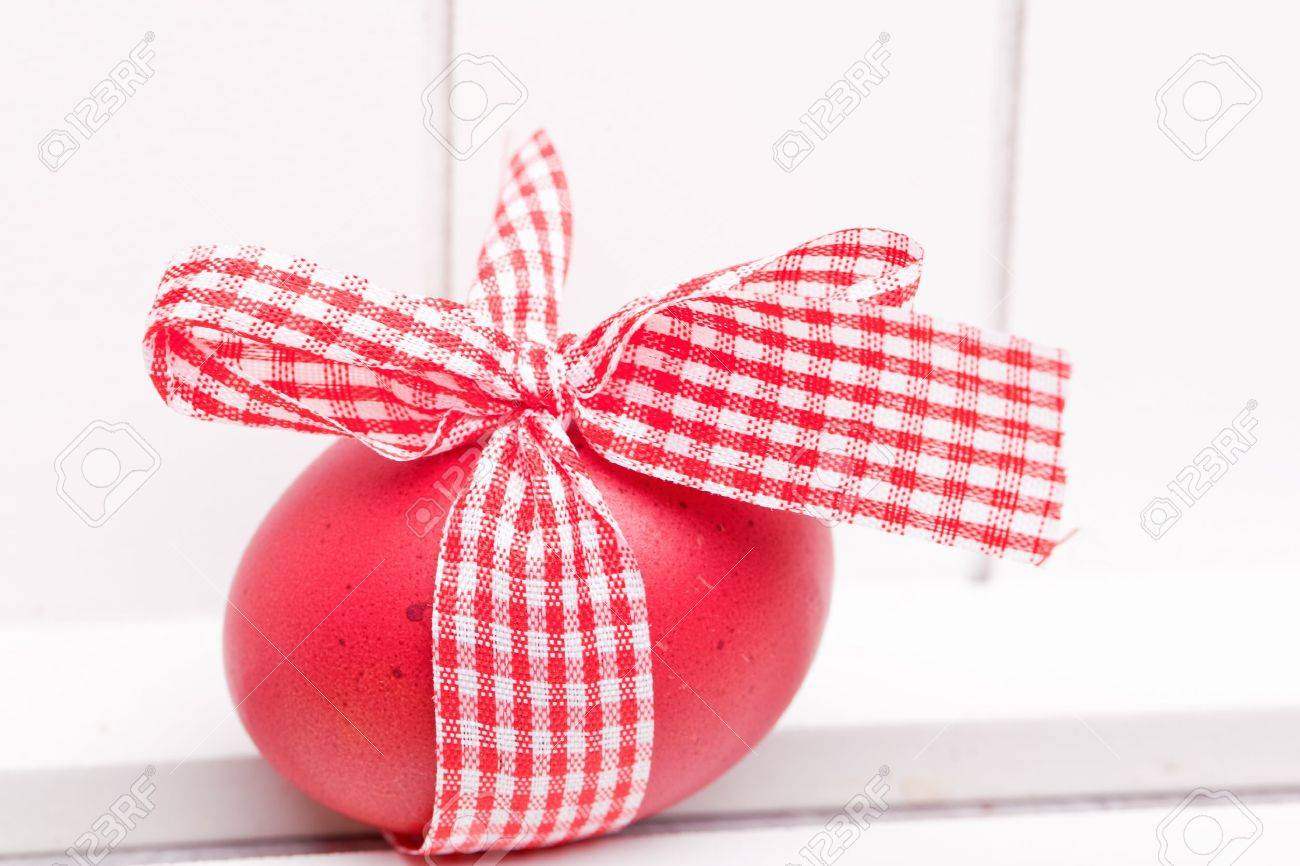 Easter egg with red white ribbon as a gift stock photo picture easter egg with red white ribbon as a gift stock photo 18155152 negle Choice Image