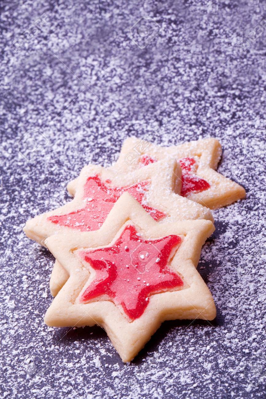 christmas star cookies with red jelly and powder sugar stock photo 22360900
