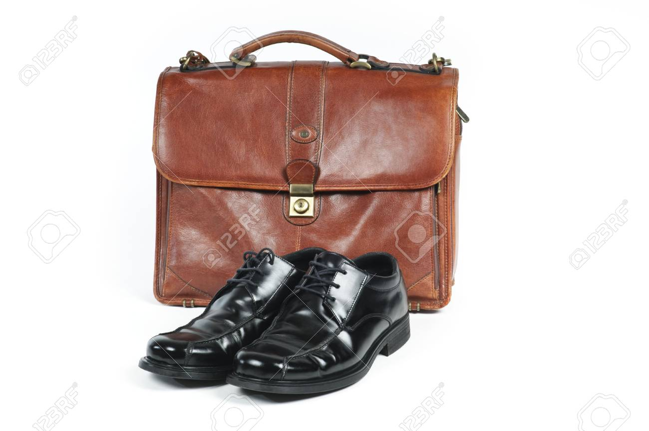 A briefcase and a pair of  shoes symbolizing a salaried employee. Stock Photo - 4964007