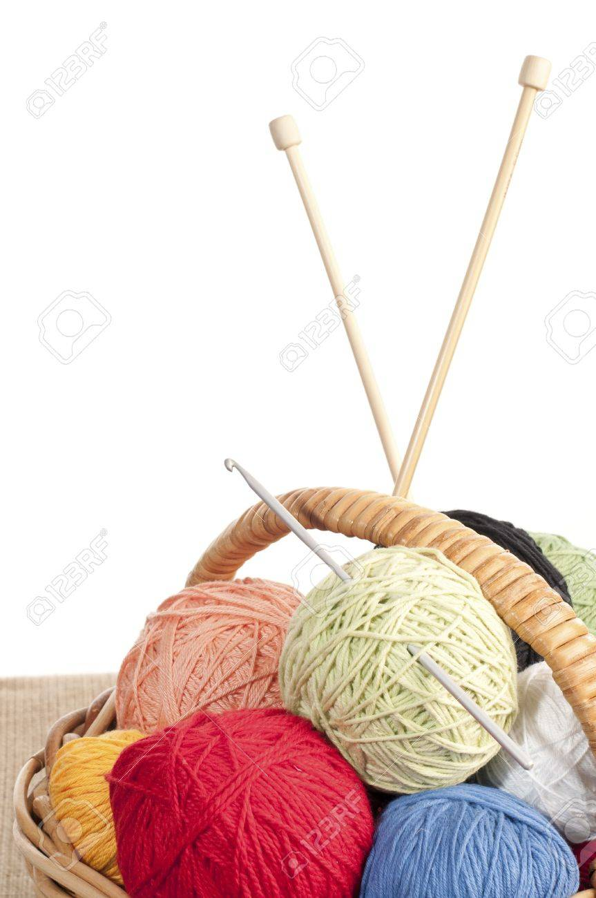 Different colored yarn in basket with knitting needle and crochet hook Stock Photo - 5028594