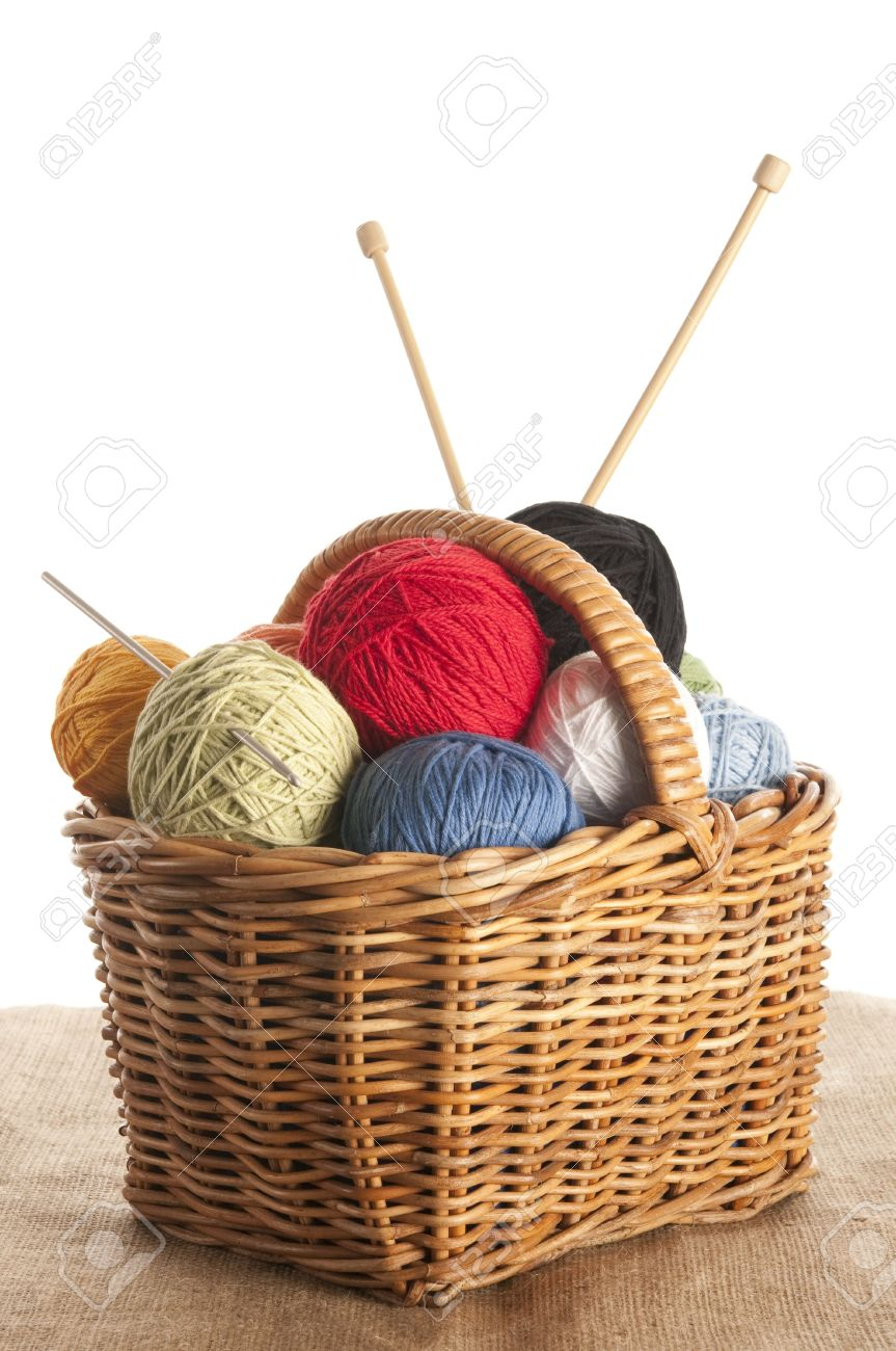 Different colored yarn in basket with knitting needle and crochet hook Stock Photo - 5028595