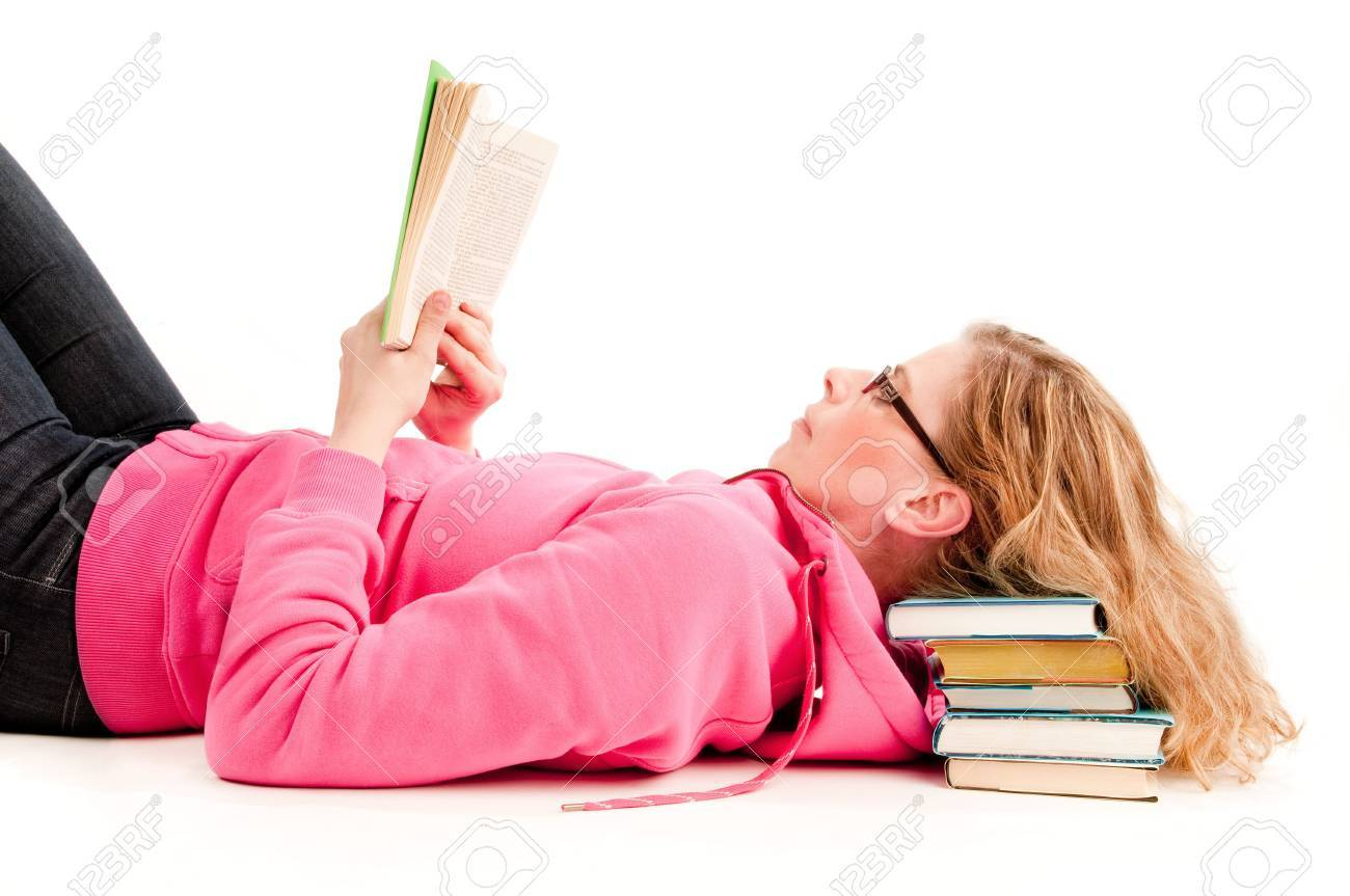 A woman reads a book resting head om pile of books Stock Photo - 6746095