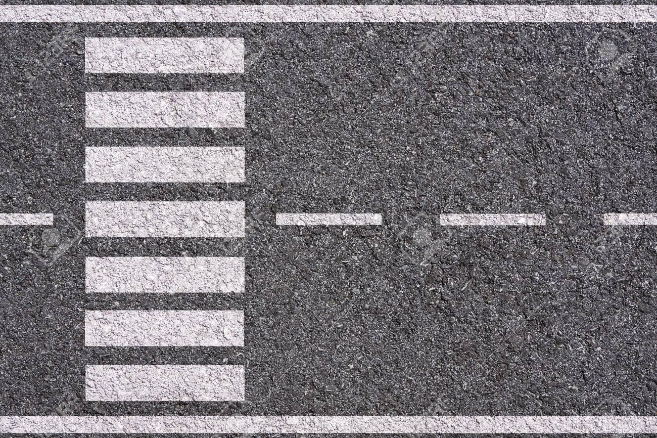 白線と横断歩道アスファルトのテ...