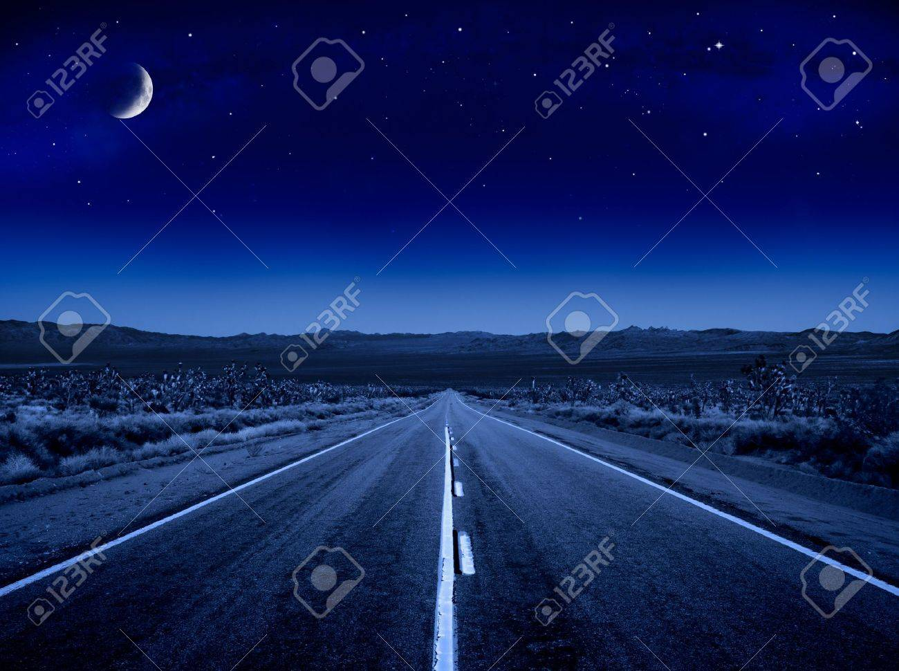 A desert road at night leading off into infinity. Stock Photo - 9728439