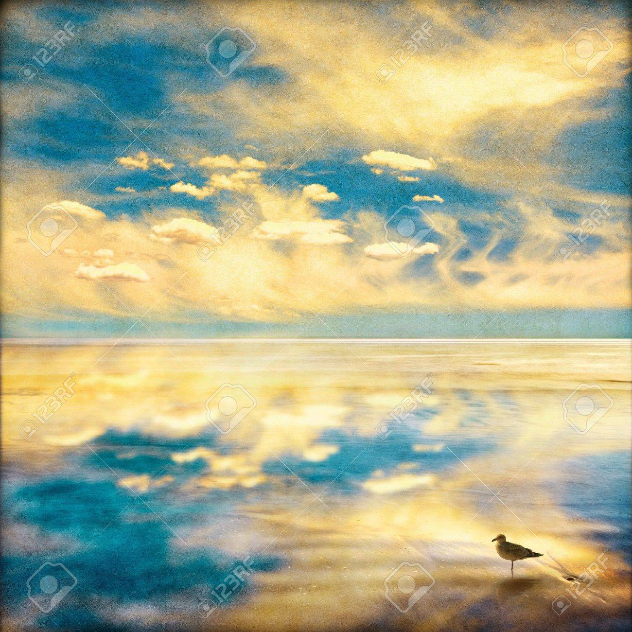 A fantasy sky and clouds seascape with a dreamy vintage look.  Image displays a pleasing paper grain and fiber texture at 100%. Stock Photo - 10032604