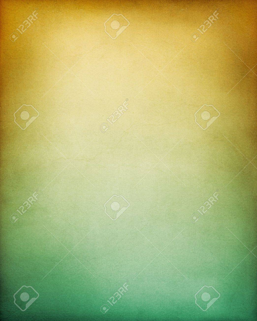 A vintage textured paper background with a yellow to green gradation. Stock Photo - 10032606