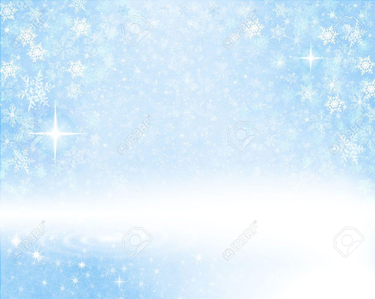 glowing snow flakes on a light blue textured paper background