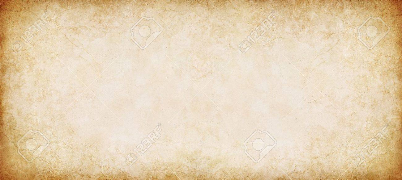 A Vintage Textured Paper Background In Panorama Format Stock Photo