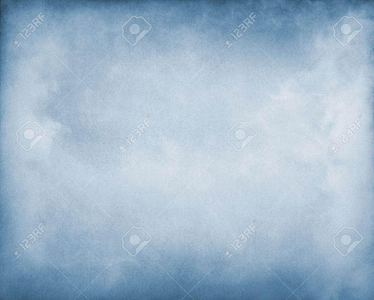 Fog and clouds on a blue paper background  Image displays a