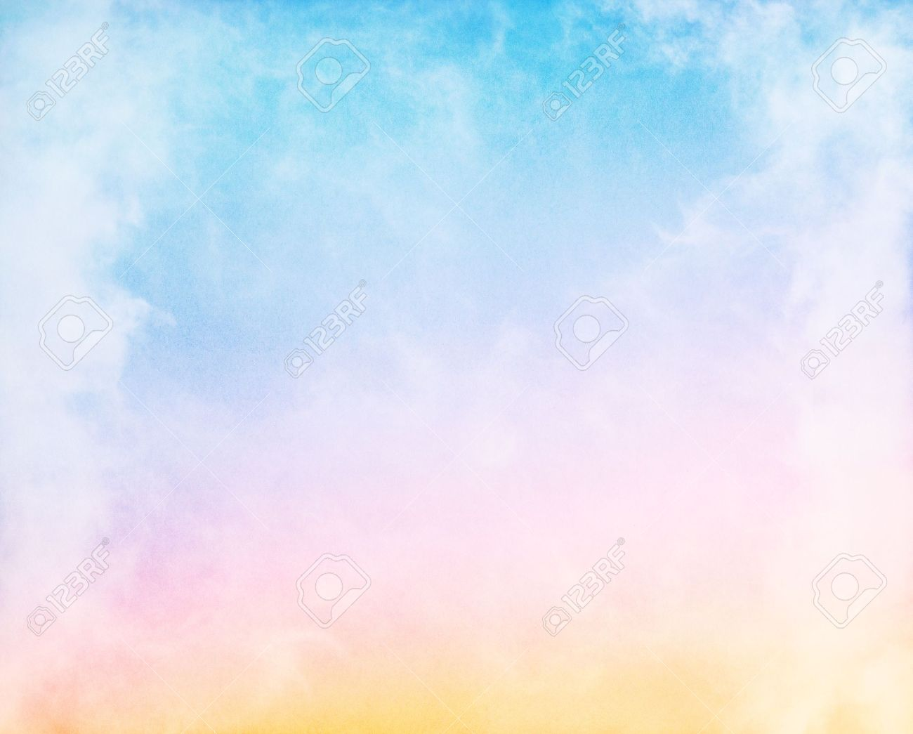 Fog and clouds on a colorful rainbow blue to orange gradient.  Image displays a pleasing paper grain and texture at 100%. Stock Photo - 13116393