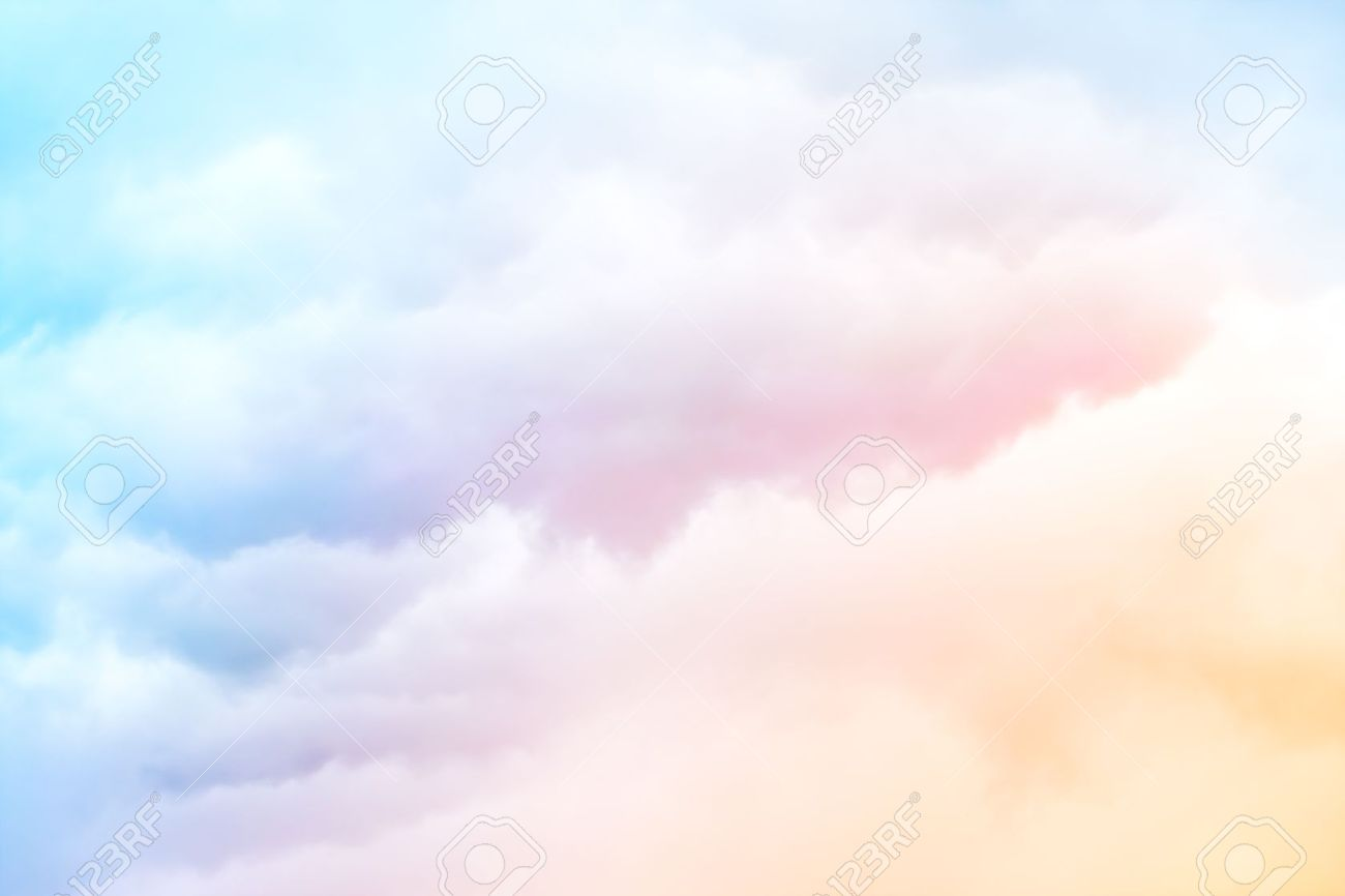 a soft cloud background with a pastel colored orange to blue stock