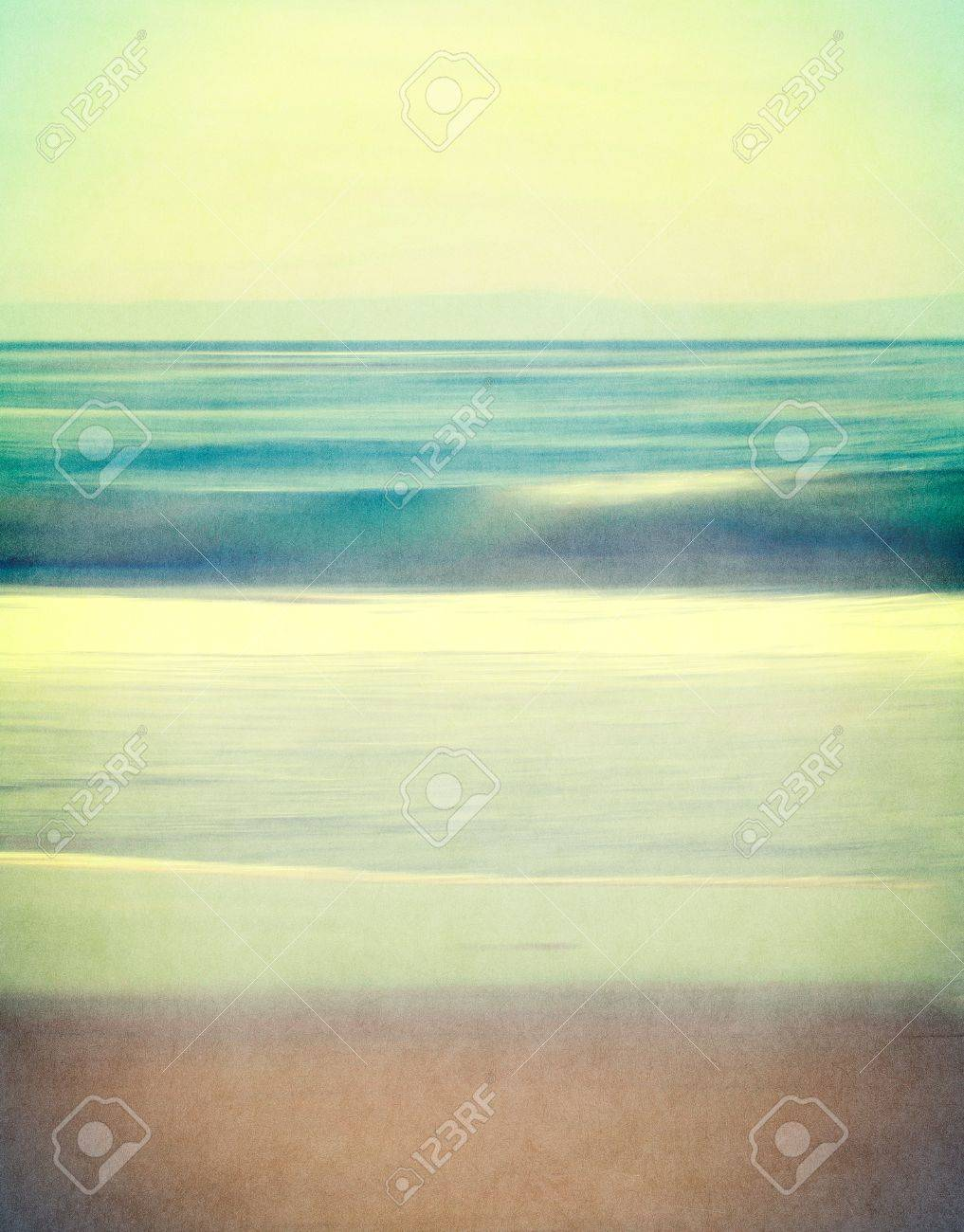 An abstract ocean seascape with blurred panning motion.  Image displays a retro, vintage look with cross-processed colors and a finely textured paper grain. Stock Photo - 21696636