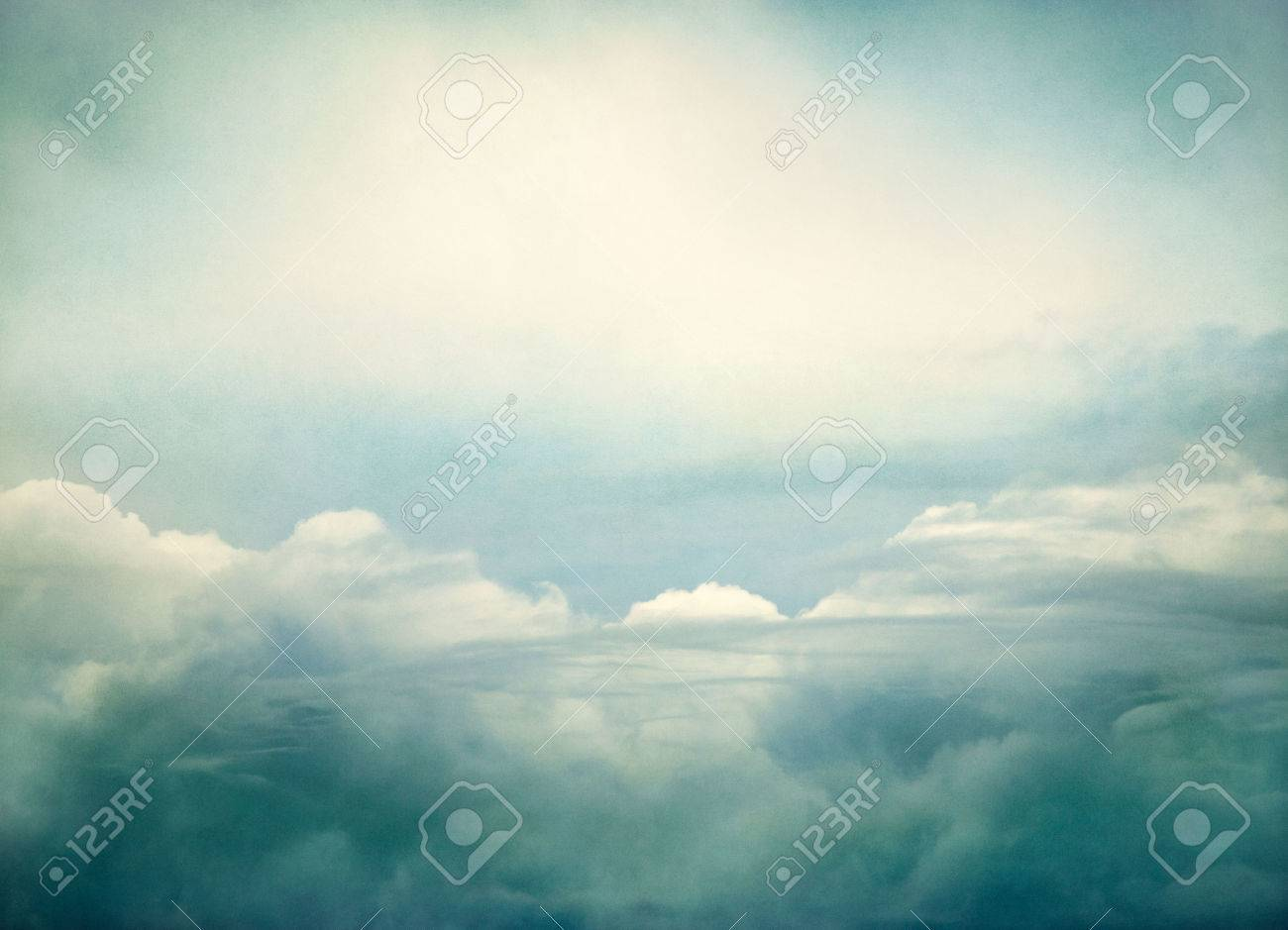 Storm clouds done with yellow and green retro colors   Image displays a pleasing paper grain and texture at 100 percent Stock Photo - 26820567