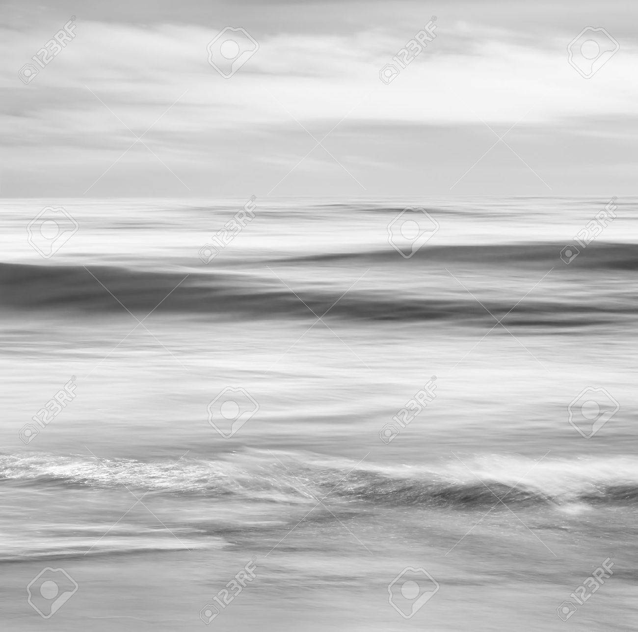 An abstract black and white seascape featuring converging ocean