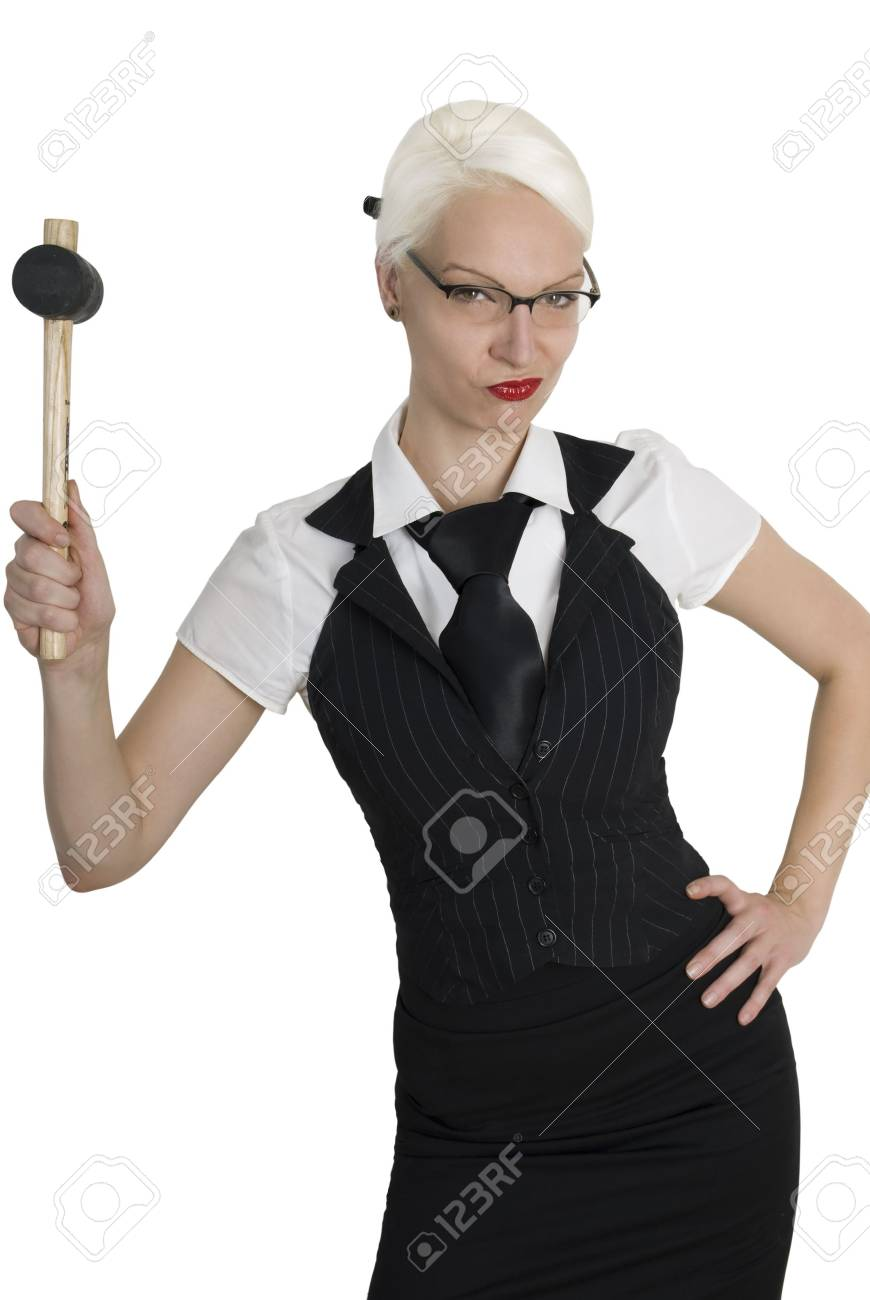 Young beautiful business woman with a hammer  in her hand. Isolated over white background. Stock Photo - 7945353