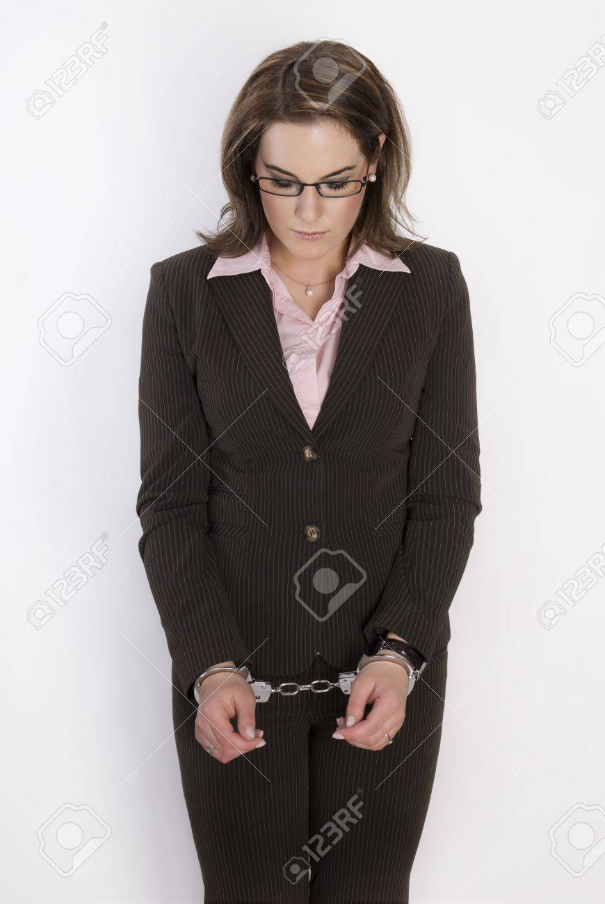 Young beautiful business woman with handcuffs on her hands. Not Isolated. Stock Photo - 8510191