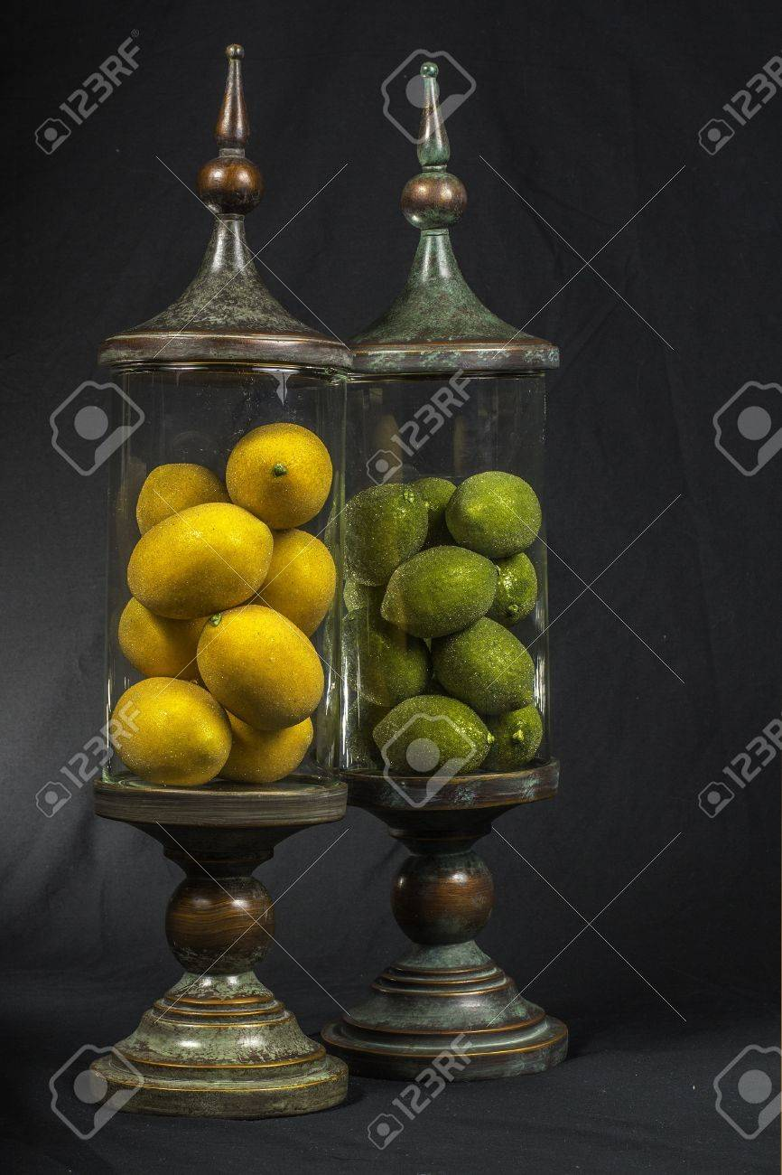Decorative Vintage Glass Jars Filled With Limes And Lemons Stock
