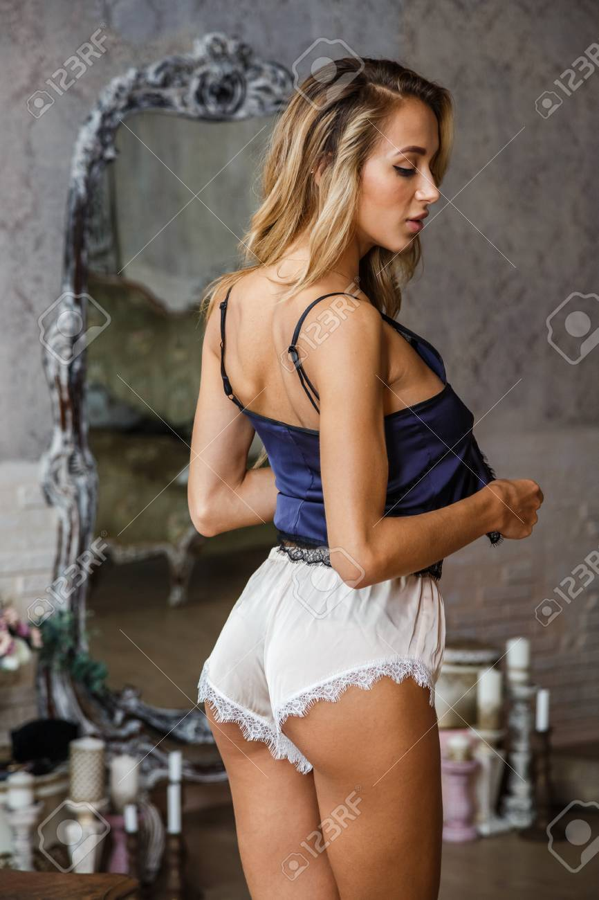 Blonde lingerie girls Beautiful Girl Blonde In Underwear And Pajamas Posing In Bedroom Interior Stock Photo Picture And Royalty Free Image Image 87348913