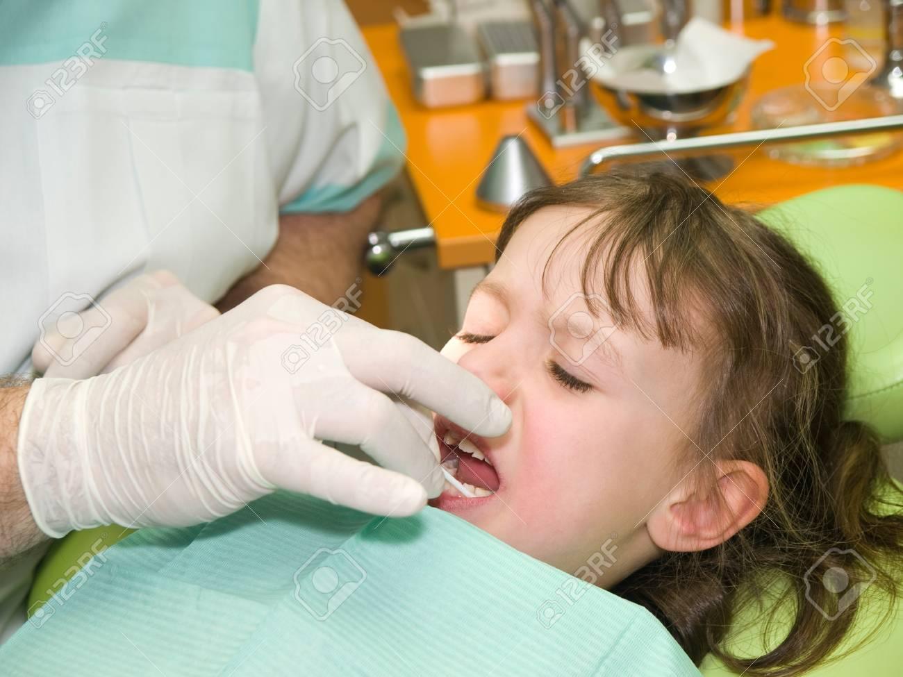 Little girl having fear of dental care Stock Photo - 9710297