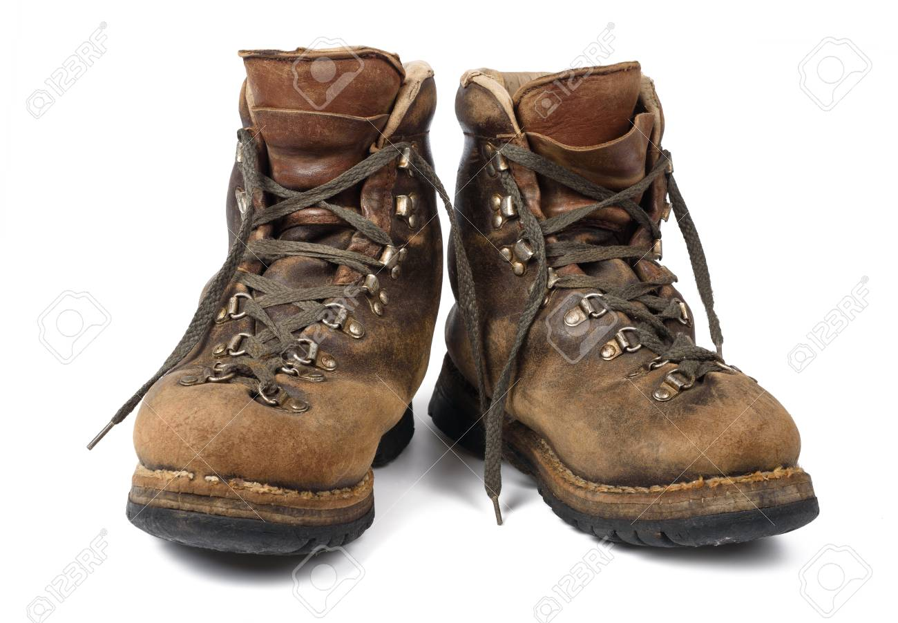68aacb899d07 Old boots used isolated on white background Stock Photo - 55997198
