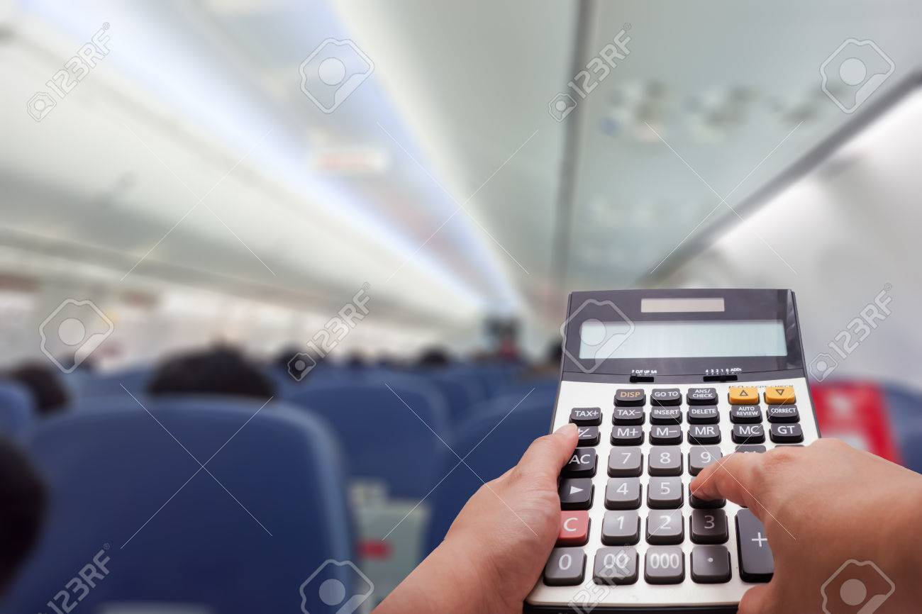 travel cost calculation concept by calculator and airplane s stock
