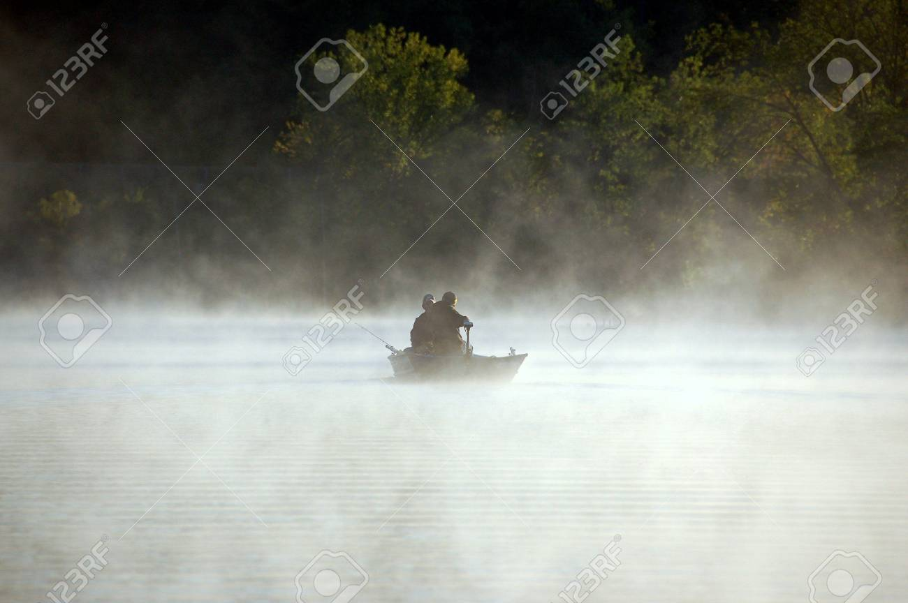Early morning mist over a placid lake Stock Photo - 7714285