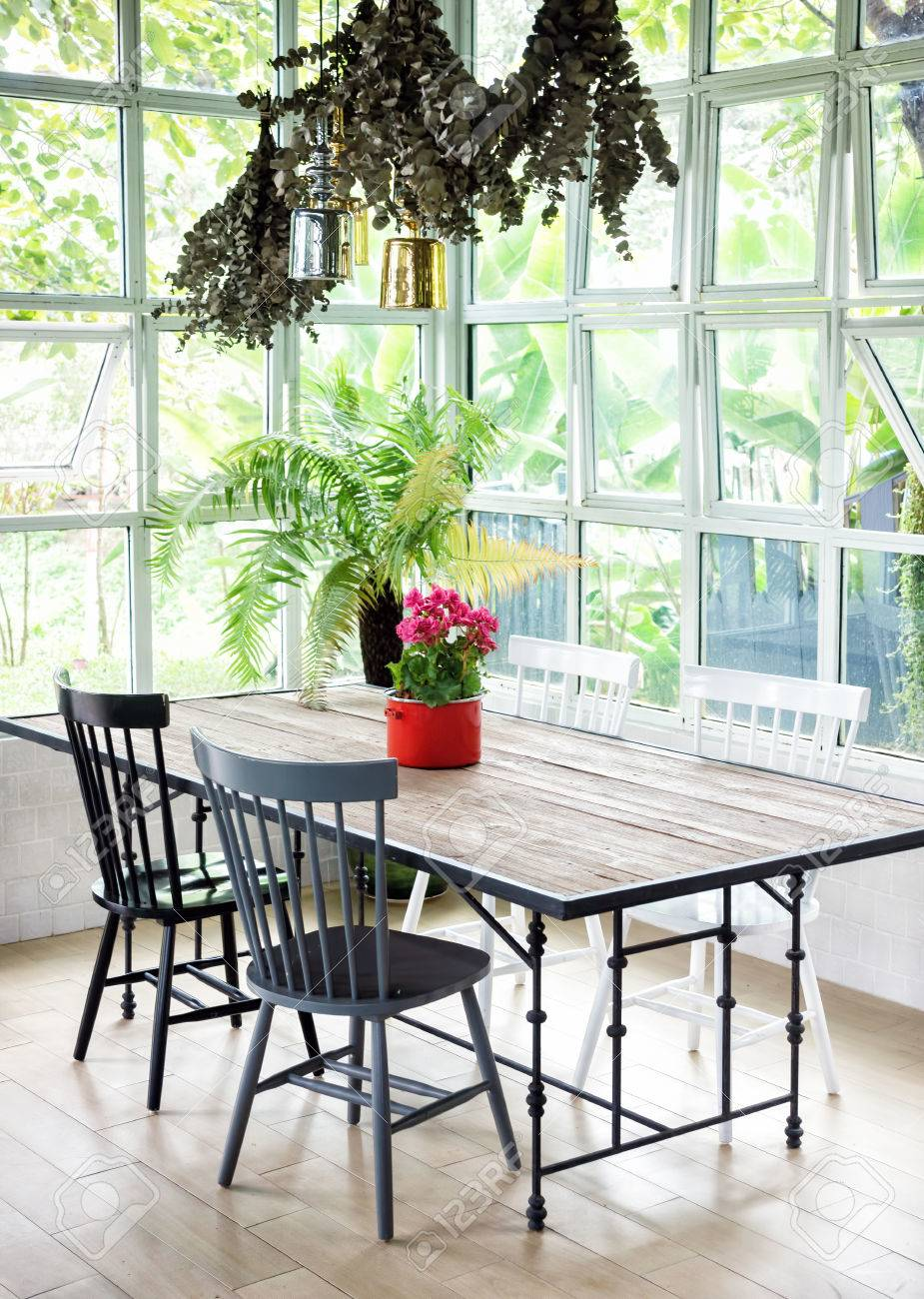 Dining Room Interior With Table Chairs And Plants Against Big Stock Photo Picture And Royalty Free Image Image 77301613